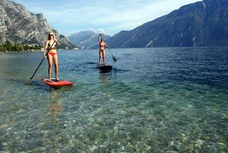 Paddle boarding on lake.