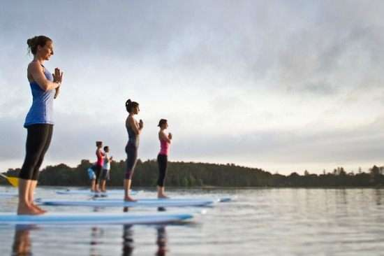 An Intro To Stand Up Paddle Boarding Yoga